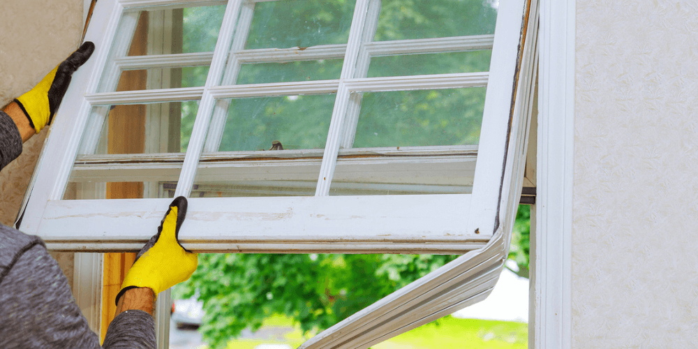 Sign that it's time to replace your windows is they were poorly installed. Image shows the removal of a poorly installed window