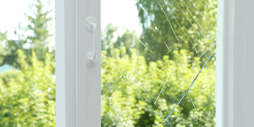 cracking glass on a window. this is a sing its time to replace them, causes major damge